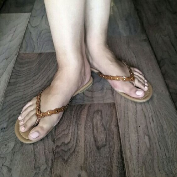 Flower Sandals NIB Cute tan sandals with brown flowers along the straps. Worn only for picture. Shoes Sandals
