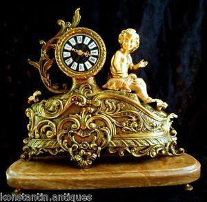 Antiques 19thC mantel clock France Bronze statue Putti Rococo Versailles Onyx