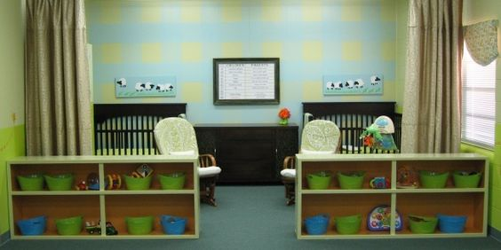 Church Nursery, love the two bookcases separating the sleeping/nursing area from the main play area