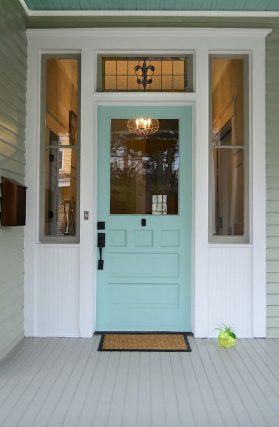 This welcoming entry uses a trio of Sherwin-Williams paint colors: exterior walls in Willow Tree SW 7741, trim in Eider White SW 7014, and that cheerful door in Hazel SW 6471.