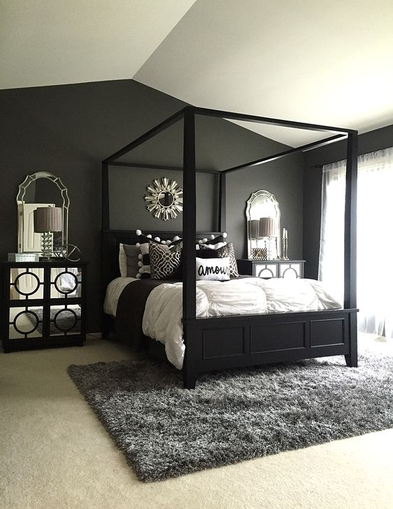 This is another darker room with plenty of black and deep gray but you get mirror accents and white to cool it out. You can see it's elegant while also being deep and dark.
