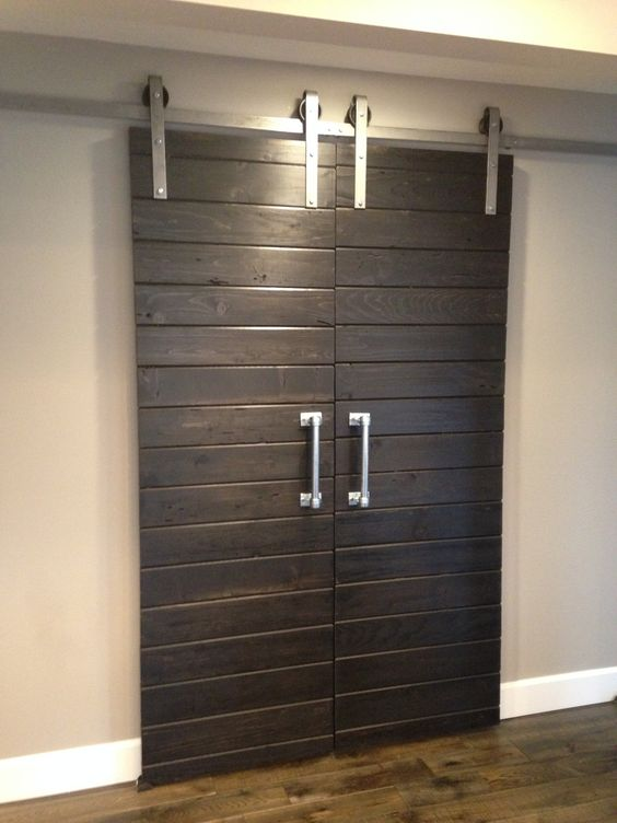 Double sliding barn door hardware kit for two doors with for 10 foot barn door track