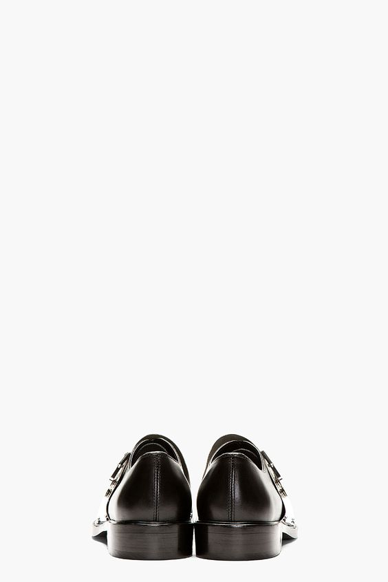 GIVENCHY // BLACK & SILVER RICHELIEU METAL BUCKLE LACE UP SHOE 41278M049001  Buffed leather metal buckle feature 'Richelieu' lace-up shoes in black. Point toe. Inverted lace-up closure. Extra wide contoured silver-tone metal snap-down buckle at vamp with hinged tab closure at outer side. Leather interior and sole. Tonal stitching. Upper: leather & metal. Interior & sole: 100% leather. Made in Portugal.