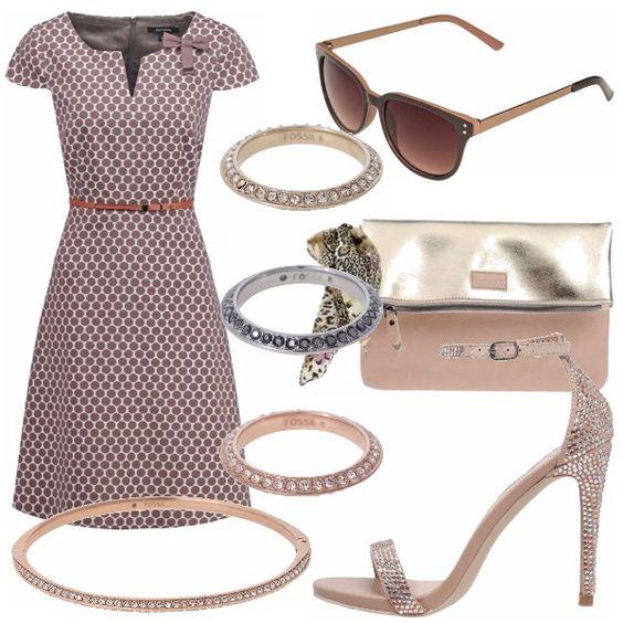 Un outfit intramontabile: gonna intera svasata geometrica con cintura in vita, sandali alti gioiello, brillanti accessori, fantastica borsa laminata color bronzo-oro.