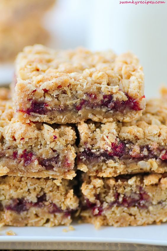 Breakfast just got a little sweeter with crumbly Strawberry Oatmeal Jam Bars made with a delectable oat crust and topping and filled with Smucker's® Fruit & Honey Strawberry Fruit Spread. They can be made ahead and uses few ingredients. #FruitandHoney #Walmart