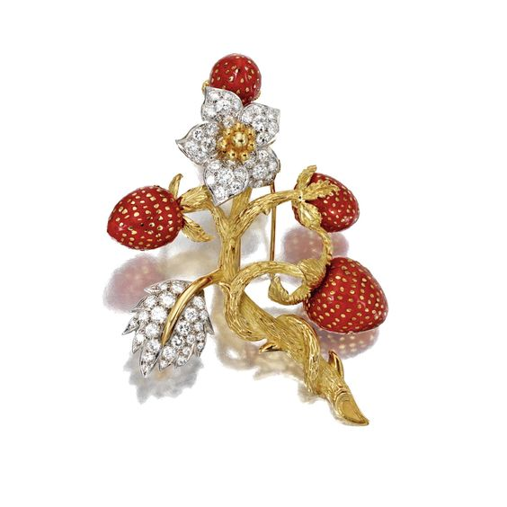 GOLD, DIAMOND AND CORAL STRAWBERRY BROOCH Designed as four carved coral strawberries on a branch of textured gold, further accented with a flower and leaf set with 59 round diamonds weighing approximately 2.75 carats.