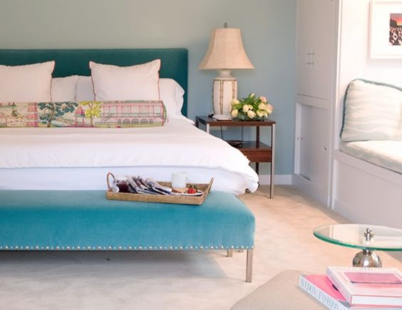 Love the look of the headboard and bench being in the same color. Also love the colorful long bolster pillow. #turquoise #pillow