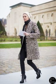 A woman wearing animal print coat, black pants, a black scarf, a white beanie, Balenciaga lace-up ankle boots & a chanel bag. Follow me on Instagram @Style DuMonde, Pinterest, Twitter, Tumblr and Facebook