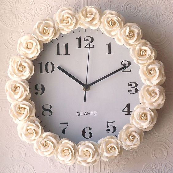 Buy a cheap clock, hot glue fabric rosettes around it... Don't love the flowers, but it's a great tip to use whatever one likes!: