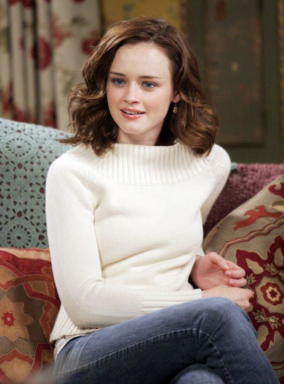 Love her hair, her sweater, and the furniture. Wonderful picture all in all