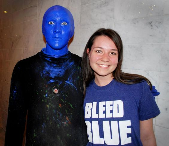 Two worlds colliding and competing for bleeding the bluest! Catelyn Thurman with a member of the Blue Man Group in Las Vegas.