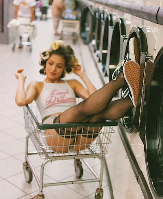 Photo by @portraits_la on Instagram. I have always really liked photo shoots that take place in laundromats. They all tend to have a similar vibe to them that strikes nostalgia in the viewer. I particularly like this shot because of the attention to detail in it. The fishnet thigh highs and the curlers in her hair add a vintage but cool look to the photo.