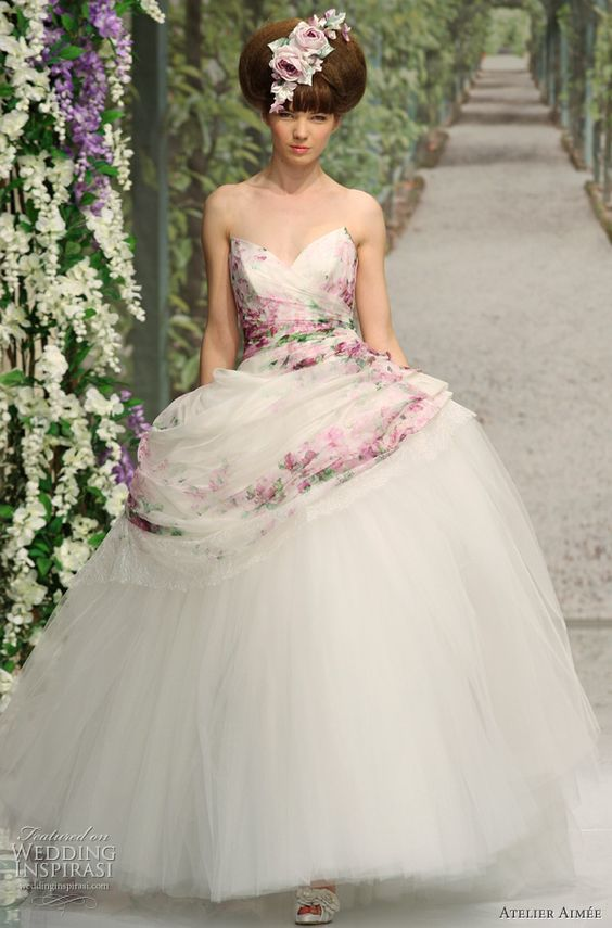 Love the floral decoration on this wedding dress.