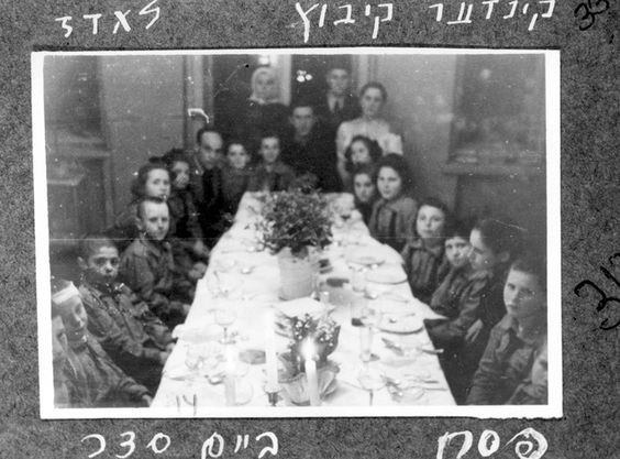 Lodz, Poland, Children of the Lodz kibbutz during the Passover seder, 1947.   Belongs to collection: Yad Vashem Photo Archive   Additional Information: Children of Kibbutz Lodz after the war. The album depicts daily life, religious life, the children and their counselors. The album was presented as a gift to William Bein, by the staff of the Joint Distibution Committee.