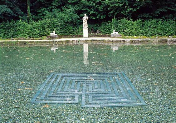 Underwater labyrinth made of glass by artist Marianne Ewaldt.     Mirror labyrinth in the trout pond  Materials: mirror, plexiglass  Length: 3.6 cm    The wedding of heaven and earth  is shown through the symbiosis of water and fire (mirror).