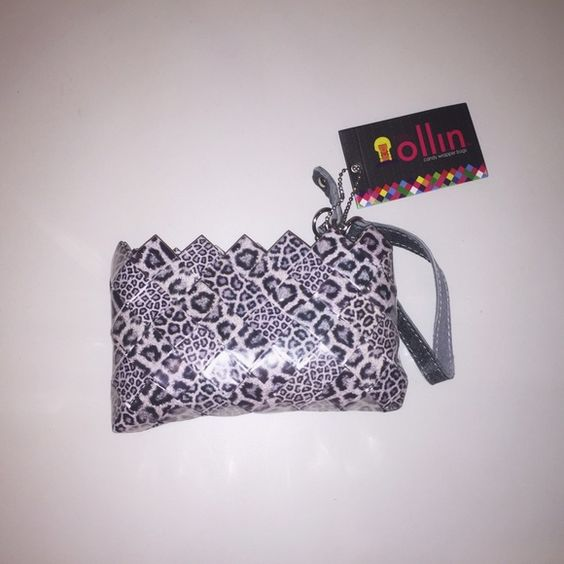NWT Ollin Clutch NWT, never used, Ollin wristlet. A these bags are made out of recycled candy wrappers. Perfect gift for anyone, especially a young child. PayPal Lowball Offers Returns Bags Clutches & Wristlets