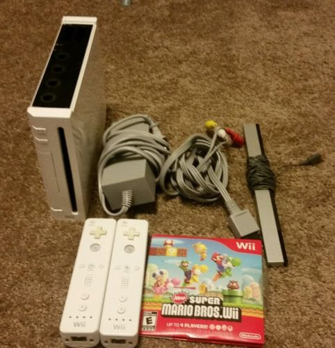 Nintendo Wii White Console (NTSC) with game  https://t.co/KaHCNUQizY https://t.co/qsA7l5N77h