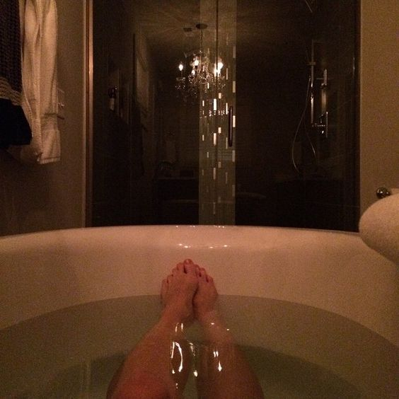 Now all I need is a cup of tea and a good book. #relaxation #relax #feet #chandelier #freestandingtub #soakingtub