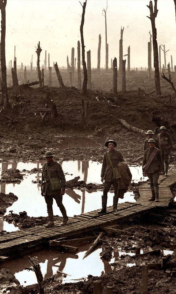 Australian gunners on a duckboard track in Château Wood near Hooge, 29 October 1917.: