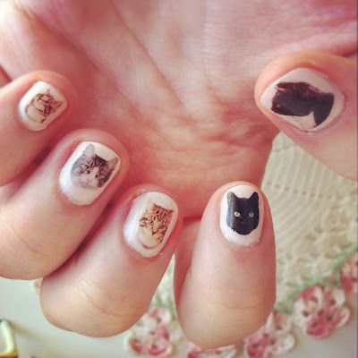 This is Stephanie's kitty nails   You can read her blog here http://www.catsparella.com/