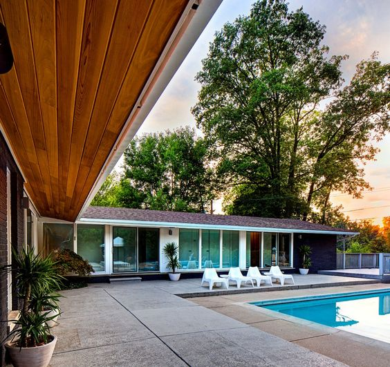 Daylight At The Swimming Pool With White  Sunspots On A Concrete Pool Side And Several Green Plants Decoration Under The Wooden Canopy Design American Storey House Mid-20th Century With Retro Details In The Interior Home design http://seekayem.com