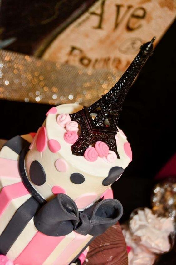 Pink and black cake at a Paris birthday party! See more party planning ideas at CatchMyParty.com!