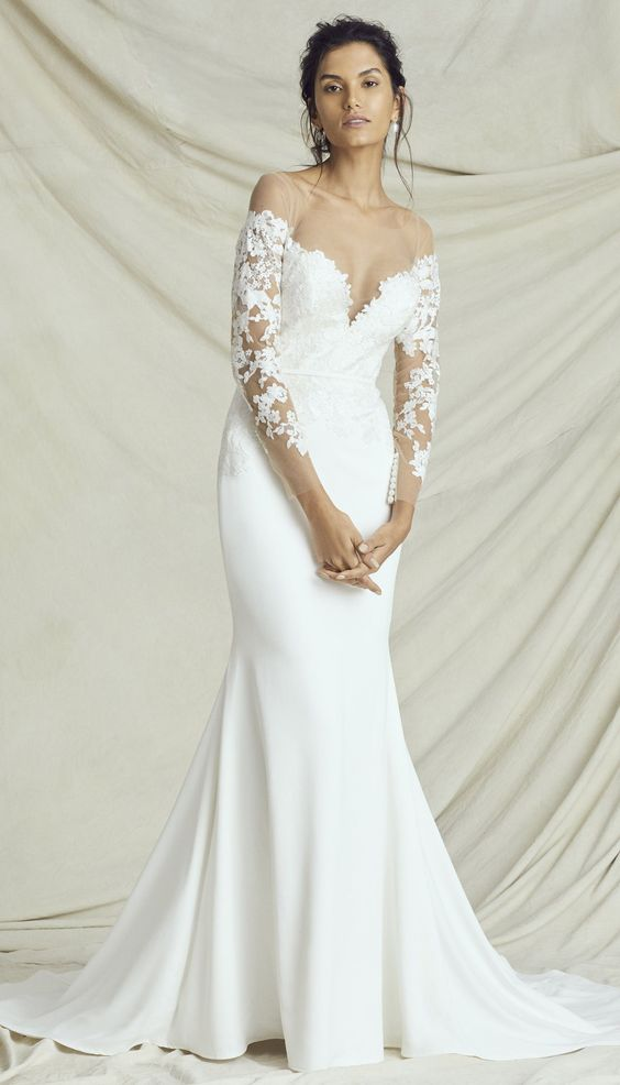 Kelly Faetanini Wedding Dresses Fall 2019 Carousel Bridal Collection. Simple sheath mermaid wedding dress off the shoulder long sleeves plunging sweetheart sexy romantic #weddingdress #weddingdresses #bridalgown #bridal #bridalgowns #weddinggown #bridetobe #weddings #bride #dreamdress #bridalcollection #bridaldress #dress See more gorgeous wedding dresses by clicking on the photo