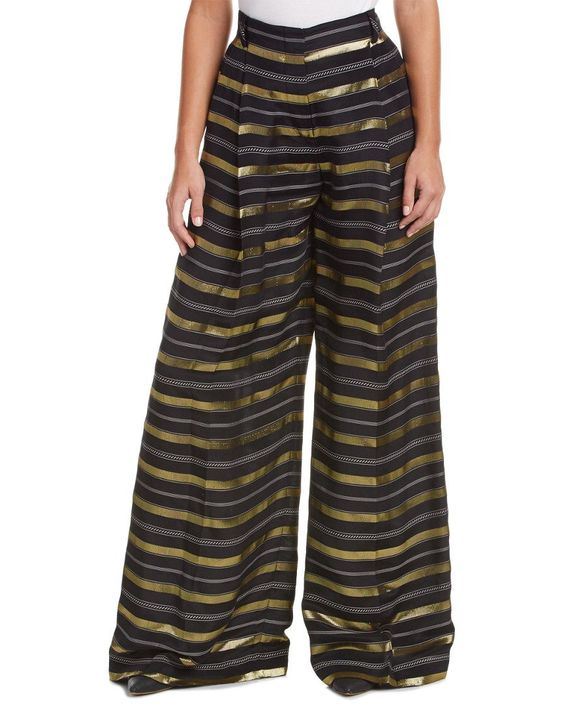 Rachel Zoe Women's Indie Wide Leg Trouser, Black/Gold, 4. Color/pattern: black and gold. Inseam approximately 36in. Measurement was taken from a size 4 and may vary slightly by size. Design details: metallic stripe design, pleating at front, wide leg, dual front pockets, belt loops, dual back button welt pockets. Zip fly with slide tab closure.