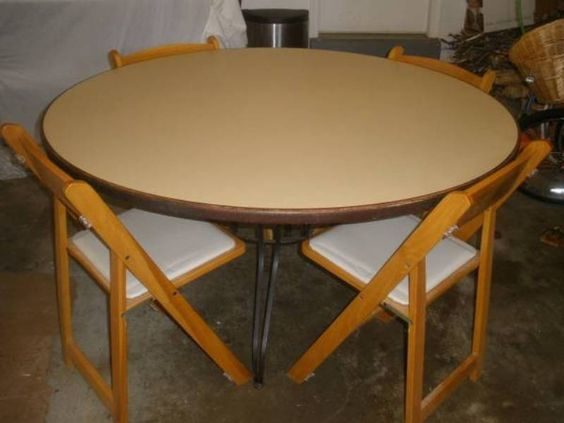 Kitchen dining room table with 4 solid wood very sturdy chairs and washable white cushions on each seat