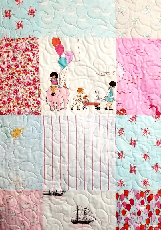 I adore this quilt with it's playful patches of playing children, circus animals, meraids, elephants, pinwheels even sail boats! These patches were chose by a 9 year old and we got to quilt it with this Feather Delight design. We joy in making the quilt of your dreams come true. From baby to birthday to Christmas and Holiday presents, we sending these quilts from our home to yours.    Come to our website and see more quilt designs that we have for you to choose from!