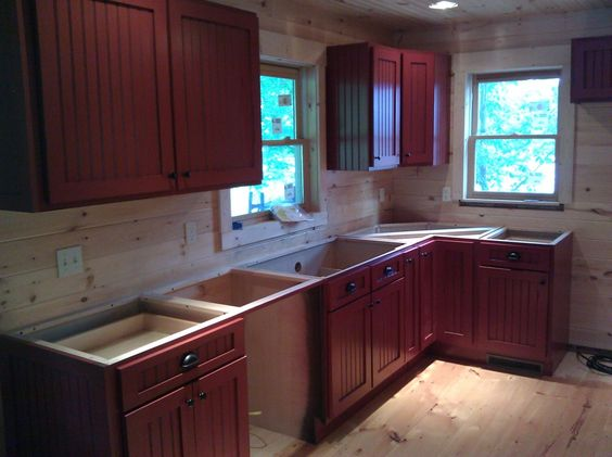 Beadboard cabinets red over black i want red cabinets soo for Black beadboard kitchen cabinets
