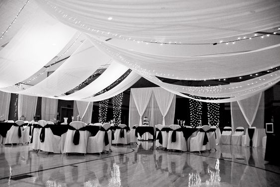 Ceiling Alternating Draping And Sting Of Lights Walls