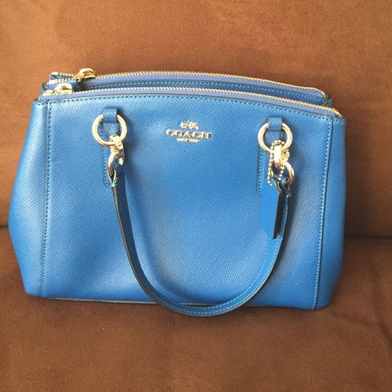 Original coach mini Christi Carryall Mini size Christi carry all coach nEw with tags has strap to convert into cross body  ! In a bright mineral blueish color . handle with 5  3/4 drop Strap with 23 1/2 drop for shoulder or crossbody wear 10 1/2 (L) x 7 (H) x 4 (W) ONLY HAVE 2 !! Coach Bags Crossbody Bags