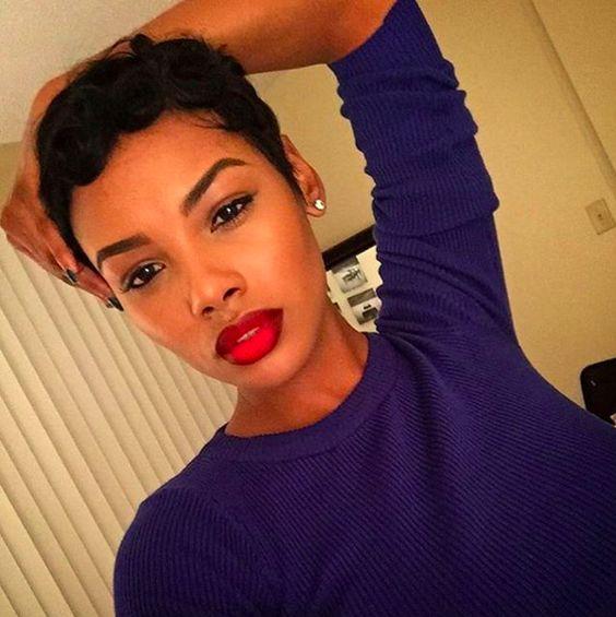 Pixie haircut, red lipstick, black woman