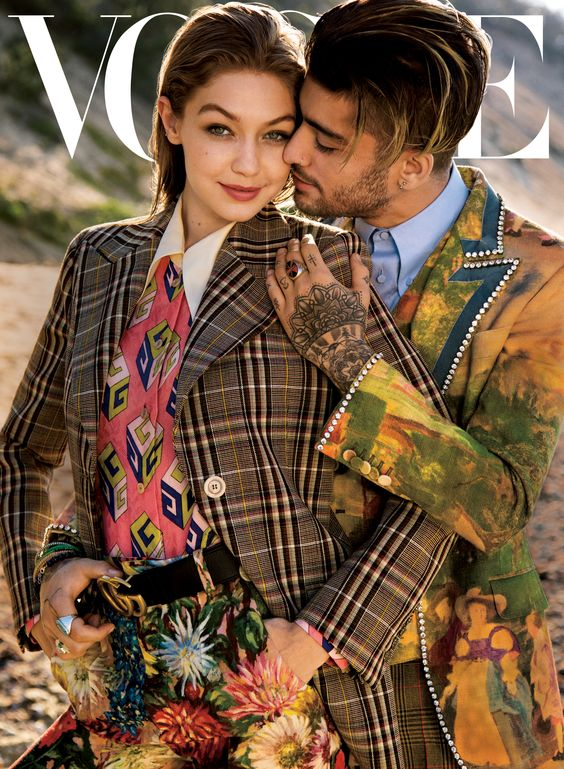 Gucci Editorials On the cover of Vogue Magazine's August issue, Gigi Hadid and Zayn Malik wearing looks from the Gucci Fall Winter 2017 collection by Alessandro Michele, including a check tailored jacket, GG Wallpaper print silk shirt, GG belt and floral pants, and a printed Heritage jacket with patch and crystal details. Stylist: Tonne Goodman Photography: Inez and Vinoodh