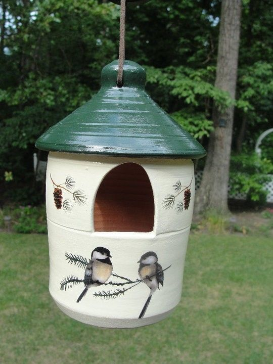 Chickadees, pinecones and pine branches on a  painted terra cotta feeder. $28.00 @EllensClayCreations