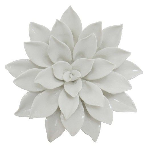 "Affiliate Pin - I love this 3 Dimension wall art from Target! The Porcelain Flower Wall Decor brings texture and natural patterning to your wall. It's made of ceramic with a glossy glaze in clean, crisp white. With its 8"" diameter, this beautiful wall accent is perfect for smaller walls or groupings of wall art."