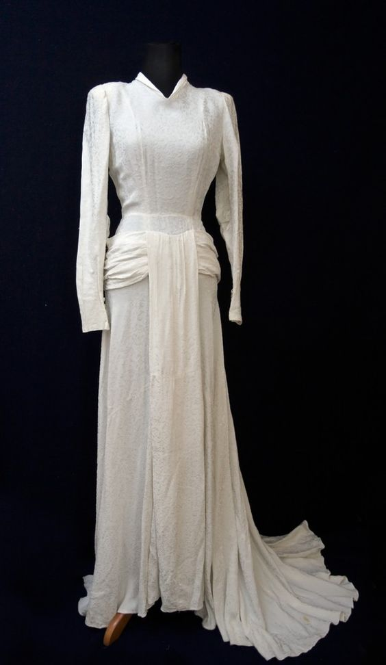 "This amazing dress was chosen by The Vintage Club as one of the top ten wedding dresses on the internet. It comes with the hand-written label that says, ""robe mariee Mamie (Jeannine) 1947"" In other words, it was Aunt Jennie's wedding dress. Thick, beautifully draped and crafted, the beauty of this dress is in its design and construction.