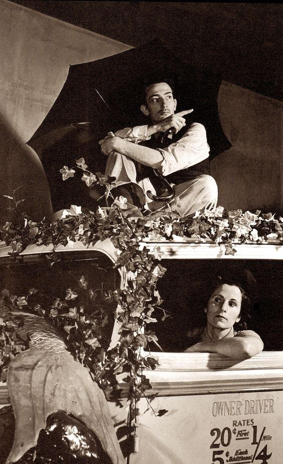 "SALVADOR DALI & his wife GALA posing with a taxi cab with a fish through the window, in one of the pavilion sets. SALVADOR DALI'S 'DREAM OF VENUS"" funhouse pavilion for adults only. At The 1939 World's Fair. from the book Salvador Dali's Dream of Venus: The Surrealist Funhouse by Ingrid Schaffner with Photos by ERIC SCHAAL. 2002 (please follow minkshmink on pinterest)"