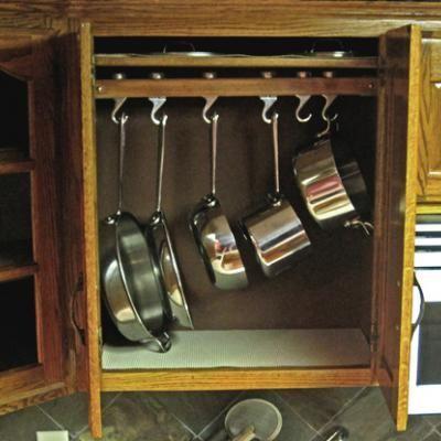 pot-rack inside the cabinet