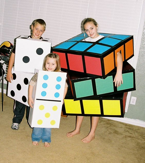Rubik's cube, dice, & domino. Boxes, black & white duct tape, colored computer paper, black & white spray paint, box cutter & scissors PRICELESS!!!!