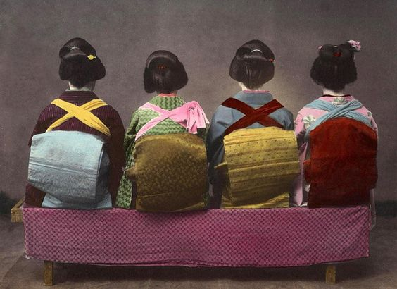 https://flic.kr/p/4UcaD2 | SHOW ME THE OBI !!!  -- Four Pretty Geisha Girls Turn Their Backs on the Photographer | Another 1890s Hand-colored SALT PRINT. You can compare print quality and the hand-tined color scheme with the same image found as an ALBUMEN PRINT here : www.flickr.com/photos/24443965@N08/2338653640/   Variations of this arrangement were taken by many photographers during the Meiji era. What are those crossed suspenders doing over the Obi's ? Are they wearing Bar-B-Q aprons on ...:
