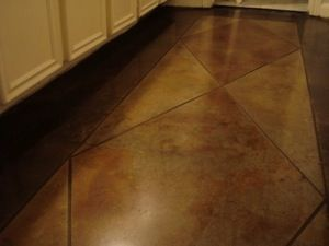 Stained concrete stamped to look like large tiles.