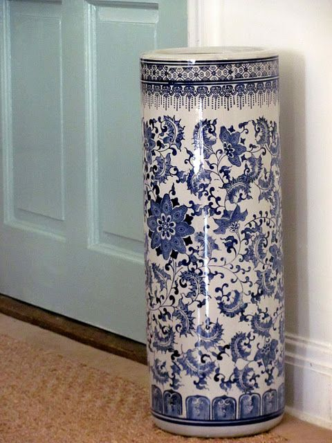 Blue and white umbrella stand.