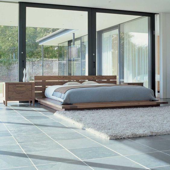 Classic Japanese bedroom in wooden design. Platform bed.