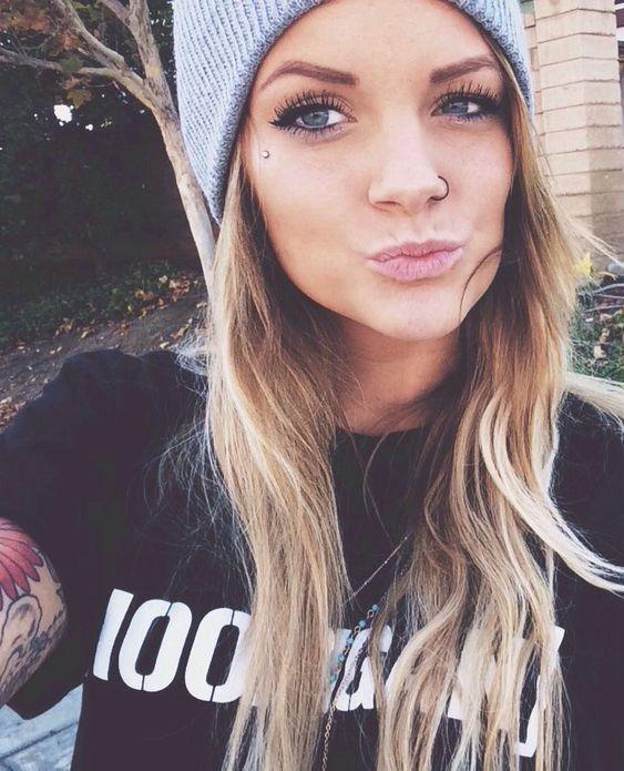 Pretty girl with cool eye dermal piercing