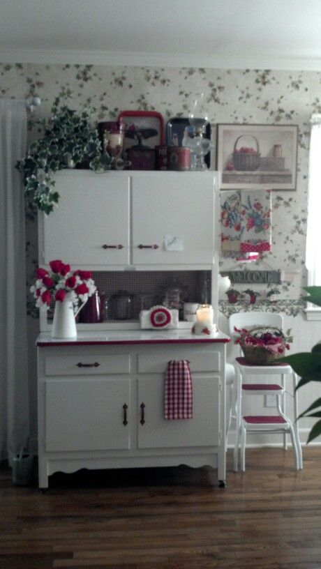 I love this look - ivy wall covering and red/white vintage hoosier & stool: