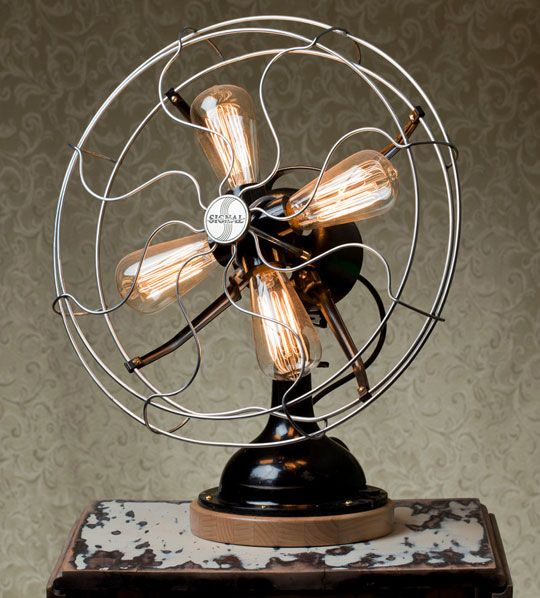 A 1939 Signal Fan transformed into a steampunk-style desk lamp, complete with four Edison bulbs