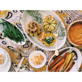 Currently on the table: stuffed sweet dumpling squash, Julia Child's Haricots Verts a la Maitre d'Hotel, roasted rainbow carrots, biscuits, cider, pie..... there's also a fire in the fireplace and the Macy's Thanksgiving Parade on in the background. Happy Thanksgiving, friends! #actuallycooking #eeeeeats #onthetable #thanksgiving