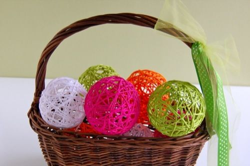 Glue Yarn Balls - use to make these with my mom on rainy days when I was little... I love the bright colors used here and how cute piled into a basket... I'm thinking you could make them in all sorts of sizes - use water balloons as forms too - and then string them together for garland... maybe string from small hooks on the ceiling to add dimension an whimsey to my girls room